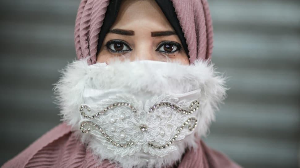 Koronaya özel gelin maskeleri moda oldu!  Gazze'de düğünlere özel maske üretiliyor