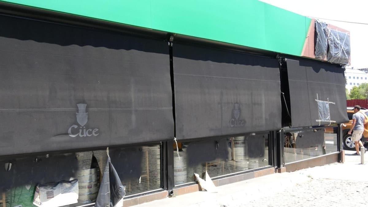 Gündem konusu olan haberlerin ardından katil Avcı'nın yakınları iş yerinin camındaki yazıyı sildiler