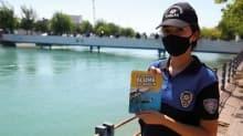 Çocuklar ölüme yüzmesin! Polis sulama kanalında nöbet tutuyor