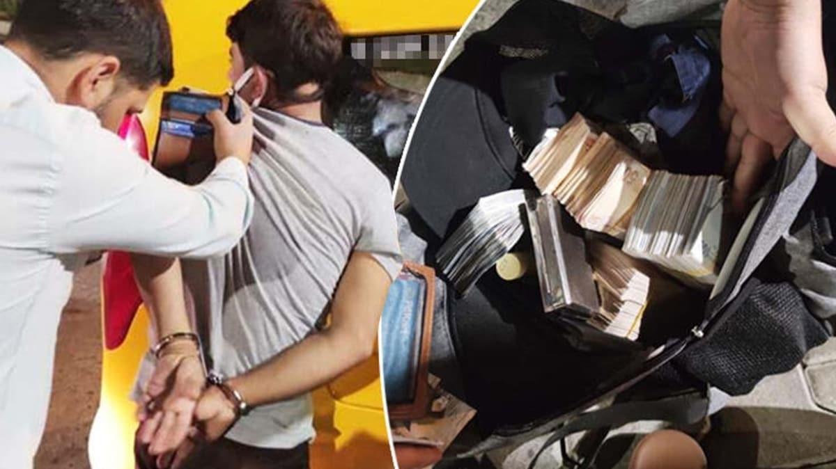 Emekli savcıyı 380 bin lira dolandıran zanlı para dolu çantayla yakalandı