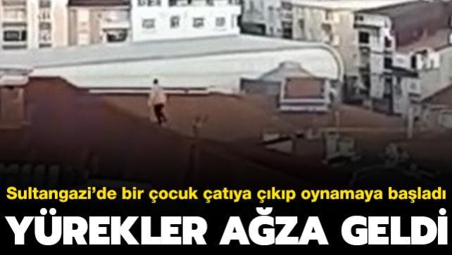 Sultangazi'de bir çocuk çatıya çıkıp oynamaya başladı... Yürekler ağza geldi
