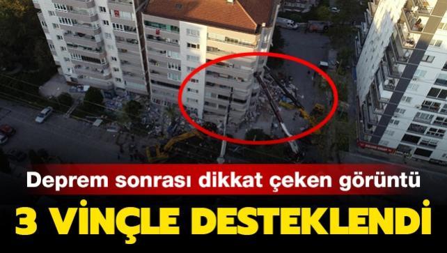 İzmir'deki deprem sonrası dikkat çeken görüntü: 11 katlı bina 3 vinçle desteklendi