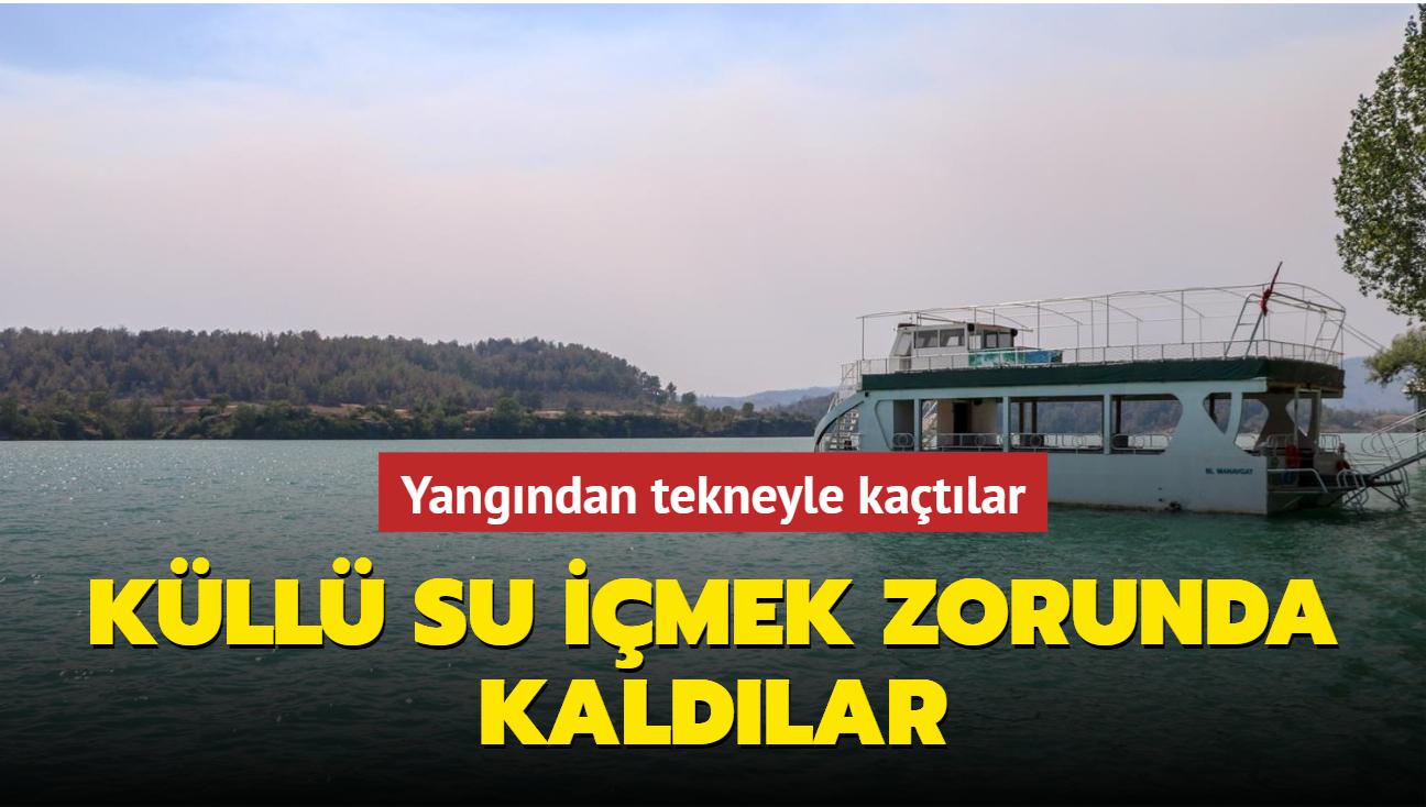 Yangından tekneyle kaçtılar... Küllü su içmek zorunda kaldılar