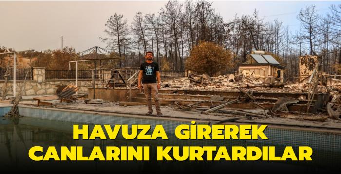 Antalya'daki yangında dikkat çeken olay... Havuza girerek canlarını kurtardılar