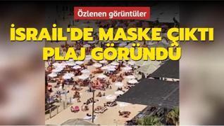 İsrail'de maske zorunluluğu kaldırılınca halk plajlara koştu