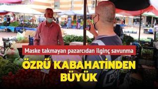 Poşetleri açmak için parmaklarını ıslatan pazarcıya ceza kesildi