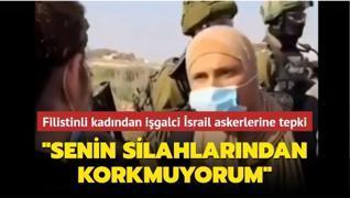 Filistinli kadından işgalci İsrail askerlerine tepki: 'Senin silahlarından korkmuyorum'