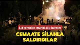 Lid kentinde insanlık dışı girişim... Cemaate silahla saldırdılar