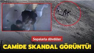 Camide uyuşturucu kullanan kişiyi sopalarla dövdüler