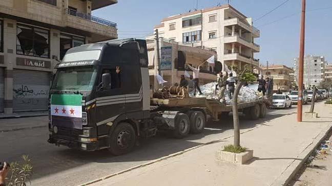 Terör örgütü PKK/PYD'nin ÖSO savaşçılarının cesetlerini sergiledikleri dorse yardım tırı oldu