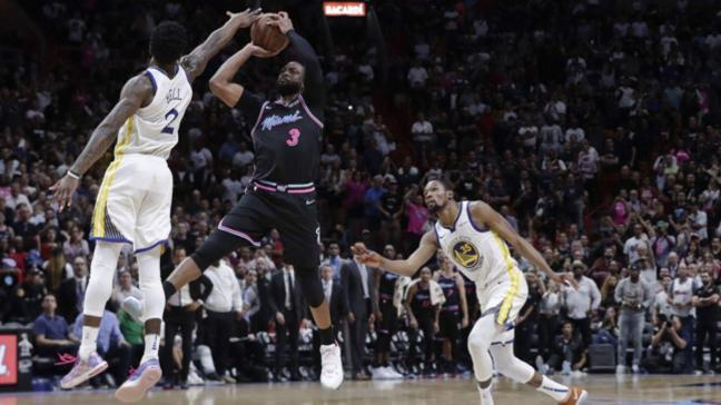 Miami Heat, son şampiyon Golden State Warriors'ı Dwyane Wade'in mucize üçlüğüyle devirdi