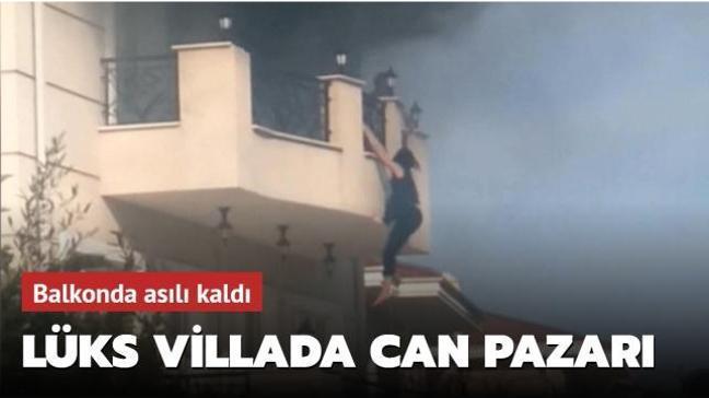 Büyükçekmece'de villada yangın: Kadın balkonda asılı kaldı