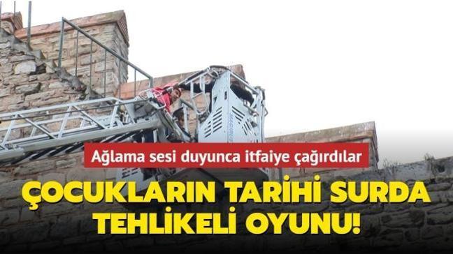 Edirnekapı'daki tarihi surlara çıkan çocukları itfaiye kurtardı